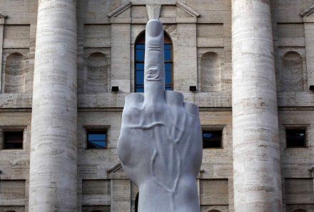 "A sculpture called "" crippled hand"" from Italian sculptor Maurizio Cattelan is placed in front of stock exchange palace in Milan"